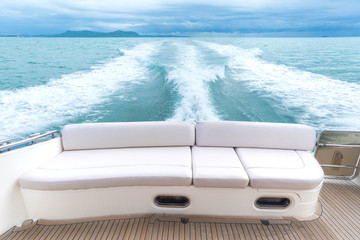 White sofa set on a luxury yacht stern interior comfortable design for holiday recreation tourism travel and vacation concept
