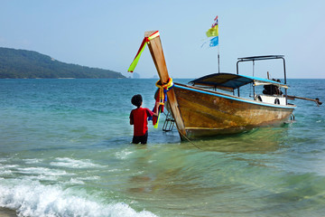 Long tail boat on Khlong Muang Beach, Krabi, southern Thailand