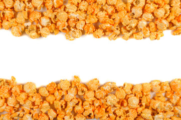 Delicious popcorn lying on the white background