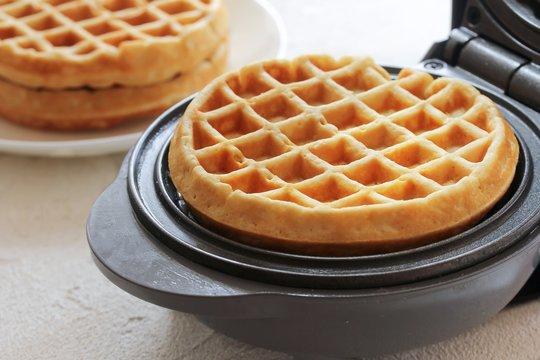 Homemade Mini waffles on Waffle Maker, selective focus
