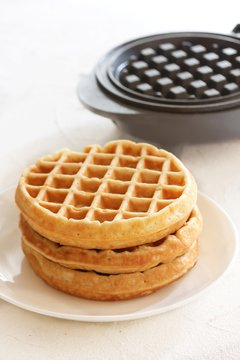 Homemade Mini Waffles stacked up, selective focus