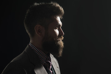 Silhouette of bearded man. Hipster profile portrait. Silhouette of handsome vintage man with bushy beard wearing stylish retro clothes. Serious man silhouette. Copy space for advertising barbershop.