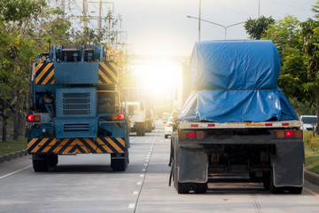 Two big truck transportation on the road for business work.