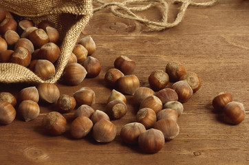 Hazelnuts in a yuta bag on wooden table