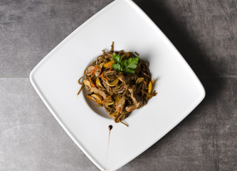 Noodles with pork and mushrooms
