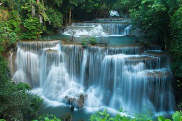 Huay Mae Khamin waterfalls in deep forest at Srinakarin National Park ,Kanchanaburi ,A beautiful stream water famous rainforest waterfall in Thailand Wall mural