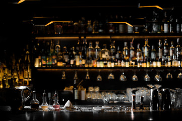 Blurred background of dark bar with barman essentials