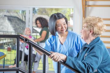 Elderly women at gym in rehab facility