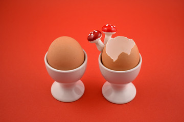 Egg decoration stock images. Funny Easter Egg. Easter egg with toadstool. Easter eggs on a red background. Spring decoration images. Breakfast still life