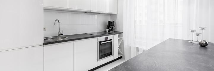 White kitchen with granite countertop