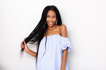 beautiful african american woman with braided hair smiling against white background