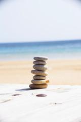 Wall Murals Stones in Sand Zen stones on a sand beach