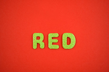 Green inscription Red stock images. Decorative green inscription. Green lettering on a red background