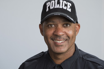 Portrait of a police officer smiling, close up head and shoulders