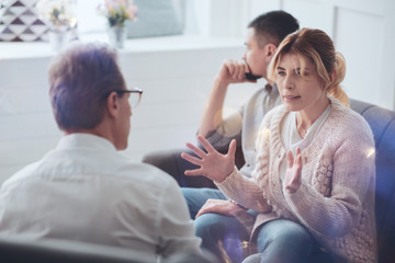 Everything is wrong. Depressed moody unhappy woman looking at the therapist and describing the problems in her relationships while asking for professional advice