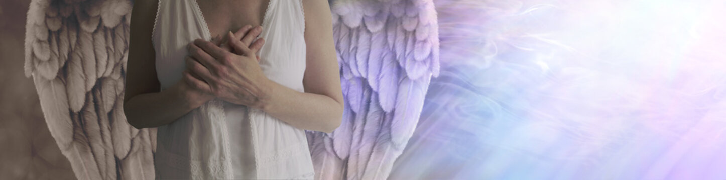 There is dark and light in all - Angel showing torso in white robes with hands held over heart with left side shaded in darkness and right side lit by a stream of heavenly white light