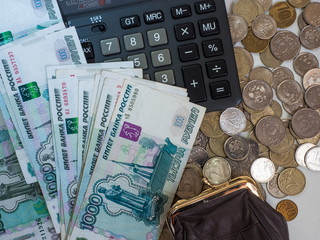 Women's wallet, calculator, lots of coins and bills in a thousand rubles