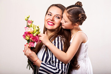 daughter gives flowers to her mother on her mother's day