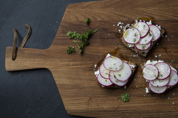 Toasts with sliced radishes, goat cheese and herbs.