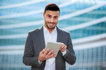 Portrait of a smiling man using a digital tablet