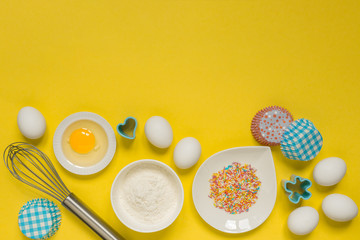 concept of the Easter bakery, various products for home baking, sugar, eggs and flour, coconut...