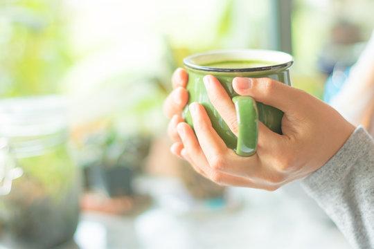 hand holing mutcha latte green tea