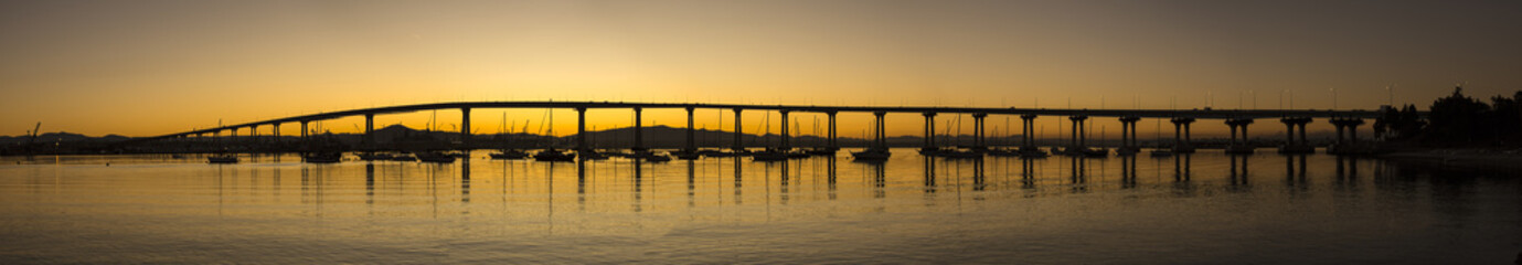 Panoramic scenic view of San Diego - Coronado Bay Bridge at sunrise