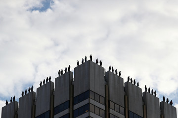 An art installation by U.S. sculptor Mark Jenkins called 'Project 84', which aims to raise awareness of male suicide rates in the United Kingdom, is seen on the roof of a building in central London