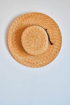 Straw hat hanging on hook.