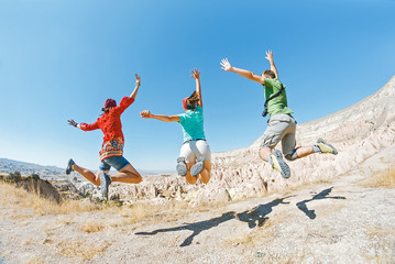 Three young friends jumping and having fun in Cappadocia, Turkey