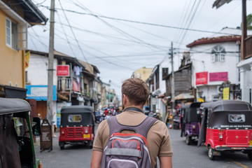 man traveling walking with backpack at small twon Galle in Sri Lanka