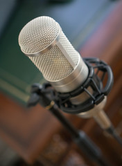 Professional tube condenser microphone in the record studio.