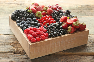 Ripe and sweet berries in wooden box