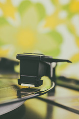 Retro styled close up of a turntable cartridge