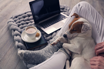 Woman in cozy home wear relaxing at home ,drinking cacao, using laptop. Soft, comfy lifestyle. Fotomurais