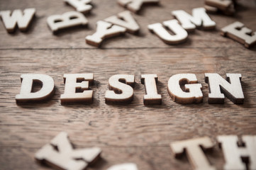 Concept word in wooden letters on wooden table background - Design