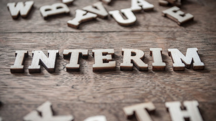 concept wooden word on wooden table background - Interim