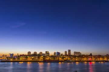 Travel Concepts and Ideas. Beautiful and Astonishing View of Rotterdam Skyline at Blue Hour Time.