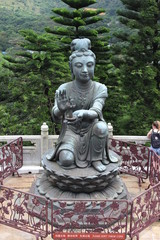 emale disciple statue offering a gift to the Big Buddha at Po Lin monastery, Lantau.