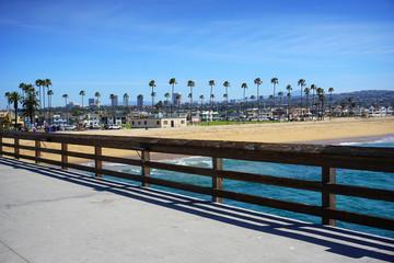 Orange County California beach and skyline from pier