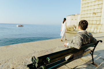 man and woman relax on sea shore