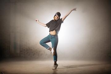 young street dancer performing ballet. doing ballet movements. rock ballet