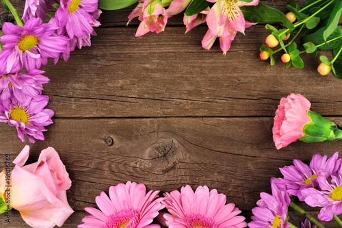 Frame Of Pink And Purple Flowers With Rose Carnation Daisies Lilies Against A