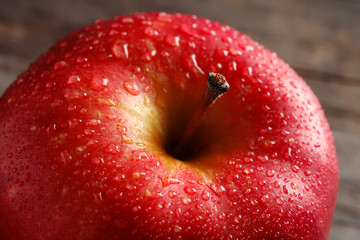 Ripe red apple with water drops, closeup