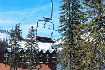 Ski lift at snowy resort in mountains. Winter vacation