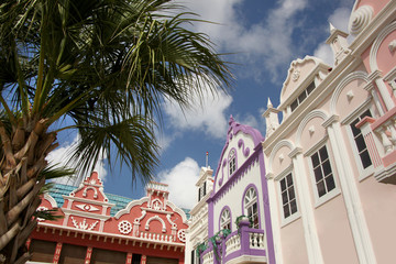 Typical pink, purple & red pastel painted architecture of Aruba, Curacao & Bonaire, Caribbean.