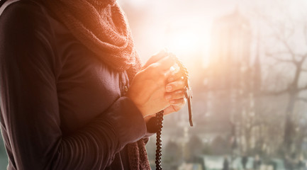 Fototapete - Christian Religion and hope concept. Woman hands praying with rosary and wooden cross.