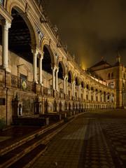 Spanish Square Plaza de Espana in Sevilla at night, Spain. It is a landmark example of the Regionalism Architecture.