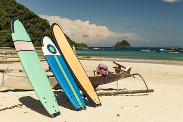 Surfboards and traditional Balinese boat