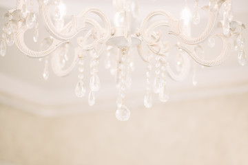 Chrystal chandelier close-up. Glamour  white background with copy space